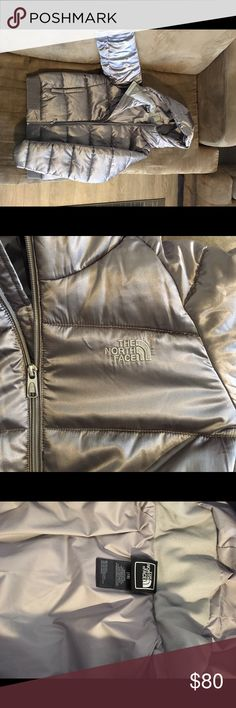 silver puffy NORTH FACE coat. Freaking cute jacket. Only worn once. like new, perfect, perfect condition. It's a size girls XL. However fits a like a S/M women's.  I usually wear a size large in women's and it totally zips up just isn't as roomy as I would like for a coat. North Face Jackets & Coats Puffers