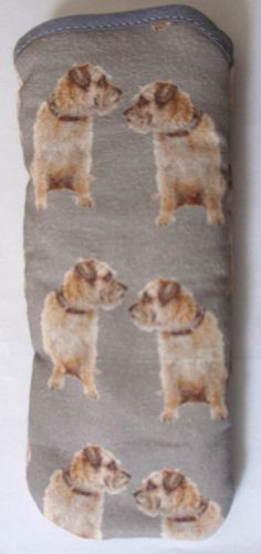 These are an unusual item, hand made glasses cases with a design of Border Terriers all over, They are nice to use for your sun/reading glasses