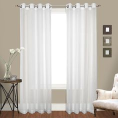 Venetian crushed voile grommet top panel pairs. Stunning elegant light-filtering crushed voile with modern grommet top. Packed as pairs. Grommet top. Polyester construction.