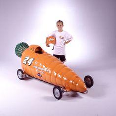 """Carrot Car            36"""" W x 30""""H x 92"""" L            Birch Plywood, Fiberglass, Steel"""