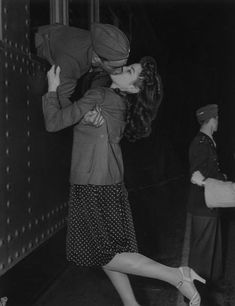 From the window of a train, Private Joe Sunseri grabs a last minute kiss on March 11, 1941, from his girl, Alma Teresi.