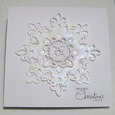 Spellbinder Fleur Di Lis set was used.  Before layering,  clear VersaMark was rubbed all over them; then they were sprinkled with Kaleidoscope EP by Stampendous; then heat embossed.