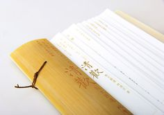 It's a conceptual book design of ''QingHuan'',a prose collection written by LinQingxuan.The Binding form of the work is Fanjiazhuang from ancient India.The cover and back cover are made of yellow bamboo pieces.The spirit of bamboo in China is similar to… Book Design, Cover Design, Yellow Bamboo, Retail Signage, Book Binding, Bamboo Cutting Board, Projects, Behance, Log Projects