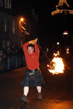 In Stonehaven, near Aberdeen, on the stroke of midnight sixty men parade the streets swinging balls of fire in the ancient Fireballs Ceremony.