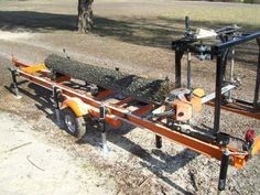 This page shows the step by step photos of a portable chainsaw sawmill that my friend Chuck and I built and my reasons for the changes we made.