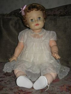"Unusual doll; vinyl and jointed from the waist up, and stuffed oil cloth from her waist to legs. She is a big doll at about 28 inches long. She has rooted hair. The marks on her are ""Effanbee 1958""."