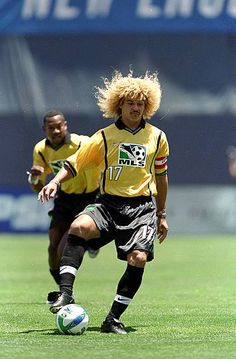 Carlos Valderrama of the East Team controls the ball during the MLS AllStar Game against the West Team at the Qualcomm Stadium in San Diego. Major League Soccer, Soccer Players, Football Kits, Football Soccer, Carlos Valderrama, Colombia Soccer, Vintage Football, All Star, T Shirts