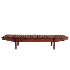 Rosewood Mucki Bench by Sergio Rodrigues   From a unique collection of antique and modern benches at https://www.1stdibs.com/furniture/seating/benches/