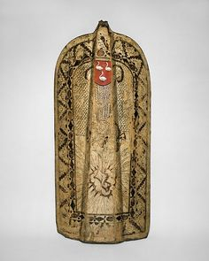 Infantry Shield (Pavise) Date: ca. 1450 Culture: Bohemian, possibly Chomutov (now Czech Republic) Medium: Wood, leather, gesso, silver foil, polychromy Dimensions: H. 42 1/2 in. (107.95 cm); W. 20 1/2 in. (52.07 cm); H. of curvature, 5 in. (12.7 cm); D. approximately 1 in. (2.54 cm); Wt. 16 lb. 11 oz. (7569 g)