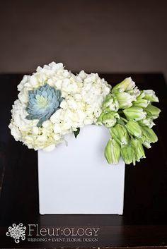 Unusual white and blue floral arrangement.