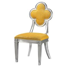 Add a pop of color to your dining table or living room seating group with this eye-catching side chair, showcasing a flower-shaped back and silver leaf finis...