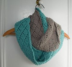 """""""Traveling eyelets form a diamond pattern in this cozy, color blocked infinity scarf."""""""