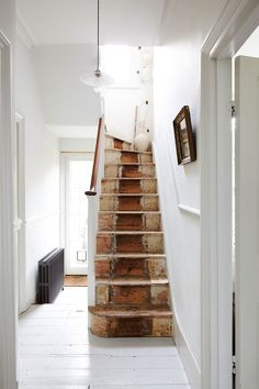 A beautifully simple location house. A neutral palette throughout with painted floorboards, original cornicing, high ceilings and a large rear garden. Painted Floorboards, Painted Stairs, Wooden Stairs, Interior And Exterior, Interior Design, Victorian Homes, Stairways, Decoration, Sweet Home