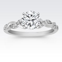 A charming infinity design in 14 karat white gold gives this engagement ring a unique look. #ShaneCoSparkle