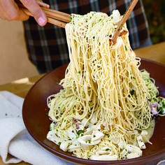 Chilled Chardonnay-Braised Calamari Pasta   Cooling this skinny pasta, then tossing it with Chardonnay-braised squid in a light, tangy sauce, makes for a refreshing first course.