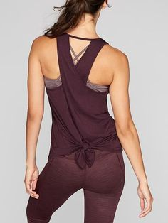 Customer-favorite, barely-there fabric goes from lunch to studio in this tank with a flowy tie back.