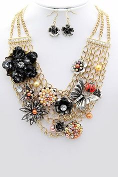 I think I could make one of these using a gold chain necklace and vintage pins and earrings.