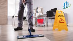 Photo about Low Section Of Male Janitor Cleaning Floor With Caution Wet Floor Sign In Office. Image of caution, sign, male - 126317803 Office Cleaning Services, Cleaning Companies, Commercial Cleaning Company, Wet Floor Signs, Janitorial Services, Residential Cleaning, Professional Cleaners, Facility Management, Busy At Work