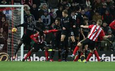 Sadio Mane of Liverpool concedes a penalty during the Premier League match between Sunderland and Liverpool at Stadium of Light on January 2, 2017 in Sunderland, England.