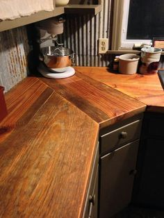 Love this wood countertop with corrugated sheet metal in Jennifer Owens' kitchen! She said her husband thinks she's crazy everytime she asks him to build stuff for her! ;D