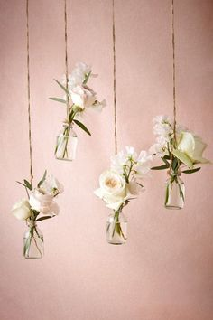Add a whimsical touch to your wedding decor with these sweet hanging bud vases #receptiondecor #weddingflorals #bhldn
