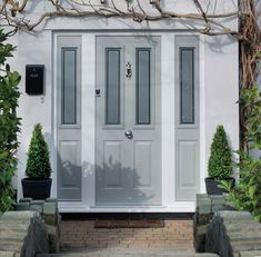 Solidor composite doors are the perfect combination of style, security and energy efficiency with a large range of colours, hardware and glazing to choose. Country Front Door, Grey Front Doors, Front Door Porch, Front Porch Design, Exterior Front Doors, House Front Door, Glass Front Door, Front Porches, Entrance Doors