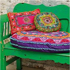 Green Bench with Colourful Cushions - Bollywood Bedlam Style Guide