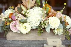 Beautiful rustic garden centerpiece filled with garden and cabbage roses, hydrangeas and ranunculus!
