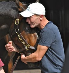 """Rachel Alexandra lays her head in the arms of an emotional Calvin Borel during their touching reunion at Stonestreet Farms this morning (5/6/12).""     What a great photo!"