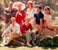 Gilligans Island....any after school must! I always loved that the 2 people who LIVED on the boat had only the clothes on their backs with them. But the people going on the 3 hour tour, had everything they owned with them.