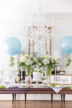 How to Host an Elegant Blue and White Baby Shower - Pizzazzerie - An elegant blue and white baby shower. Southern touches from charming boxwood wreaths to the perfect baby shower favor for guests! Baby Shower Azul, Mesas Para Baby Shower, Baby Shower Flowers, Baby Shower Table, Baby Shower Cupcakes, Floral Baby Shower, Shower Party, Baby Shower Parties, Spa Party
