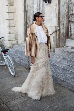 Jenna Lyons in a feather maxi skirt and fur coat