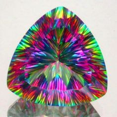 In the case of 'Mystic Topaz', the coating creates interference effects, displaying a rainbow effect of various colors. This is on real topaz.