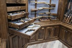 A design and build shop in Arkansas crafting the finest Trophy Rooms, Gun Libraries, Kitchens, Architectural Mill-work, and more throughout the world. Hidden Gun Rooms, Hidden Gun Storage, Weapon Storage, Gun Safe Room, Hidden Gun Cabinets, Gun Closet, Reloading Room, Gun Vault, Trophy Rooms