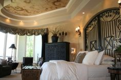 Use wrought iron gates for a headboard.