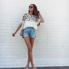White embroidered blouse with high waisted Jean shorts