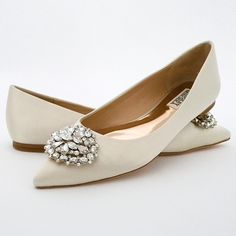 Glam flats! Classic pointed toe flats with a dazzling rhinestone ornament at the toe in classic Badgley Mischka bling style  See more here:…