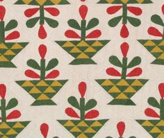 """Folk Art Flower and Basket, c. 1850, 74 x 82 inches, Pennsylvania. Solid colored fabrics in Turkey red, over dyed green & mustard on white background; baskets are 3.5"""" high, 7.25"""" wide.  Triple quilting line in 1/4"""" parallel lines, backing fine white cotton, 1/4"""" binding in Turkey red"""