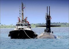 DIEGO GARCIA (March 2008) A tugboat from Navy Support Facility Diego Garcia helps guide the fast-attack submarine USS Dallas (SGN 700) through the shallow lagoon as the submarine pulls into port to conduct a voyage repair period. Dallas is on a scheduled six-month deployment to the European and Central commands areas of responsibility.