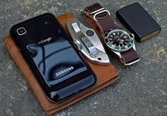 submitted by Sergiu M    This is what I have in my pockets today:  *Samsung Galaxy GT-I9000*Fossil tan bi-fold wallet*Spyderco Dragonfly VG10*Marcello C Nettuno 3 watch on a Shell Cordovan nr. 8 leather NATO strap*Zippo lighter  I recently repaired my Olympus DSLR and even though I have yet to learn how to use it properly, I hope this picture is a bit closer to the high standard of the great submissions on your blog.    Editor's Note: Nice carry here — albeit even more minimal than most (n