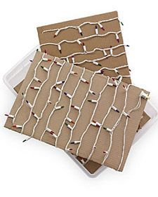 Christmas Lights Organization | Next year, don't spend a minute sorting through tangled webs of holiday decorations. Keep lights organized by winding each strand around a piece of cardboard cut to fit in a plastic bin | #ChristmasOrganization