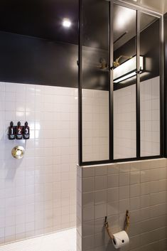 metal frame factory style windows and half wall separate great walkin shower, change all that black paint, fixtures to chrome/nickel, like the mix of tile patterns, bathroom at Ace Hotel, Los Angeles