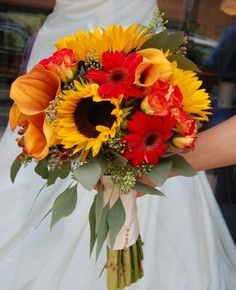 sunflowers, red gerbers, and orange calla lilies
