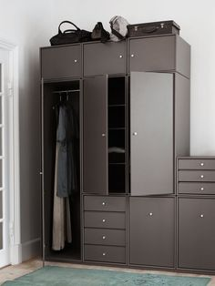 Montana Wardrobe in the colour Coffee. Montana Wardrobe is a flexible storage solution that allows you to express your own personal style, colour scheme and needs when designing your wardrobe. #wardrobe #closets #storage #bedroom #hallway #montana #furniture #danish #design