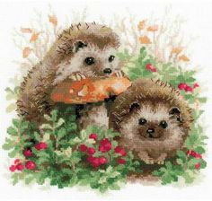 Riolis Hedgehogs In Lingonberries - Cross Stitch Kit. This cross stitch kit contains 14 count white Zweigart Aida fabric, woolen and acrylic yarn Safil in twent