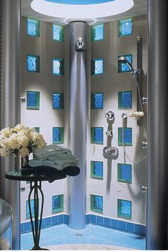 This contemporary shower has a clean almost space age type of look. The chrome fixtures and the blue colored glass blocks really make it a wow look! Click here to learn more http://blog.innovatebuildingsolutions.com/2014/11/08/5-design-ideas-modernize-glass-block-wall-window/ #CoolBuildingProducts #InnovateBuilding