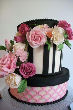 Hatbox Cake.  Fondant over ganache.  Used Marvelous Molds Lattice Onlay for bottom tier. Gumpaste flowers.
