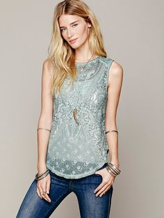 Beautiful detail top in slate green 98.00 It deserves better than blue jeans, though.