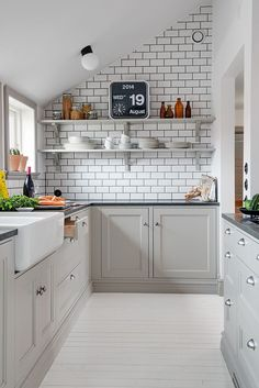 gray cabinets, white subway tile with dark grout, open shelves