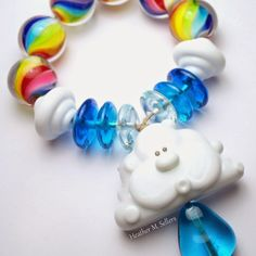 Silver Lining.  A lampwork glass bead set by Heather Sellers. #rainbow
